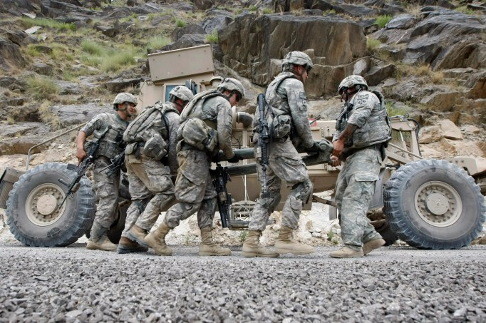 US soldiers of the 2-12 Infantry, 4th Brigade prepare to tow a broken-down improvised-explosive-device (IED) detecting Huskie vehicle during a patrol in the Pesh Valley in Afghanistan's Kunar Province, July 30, 2009.