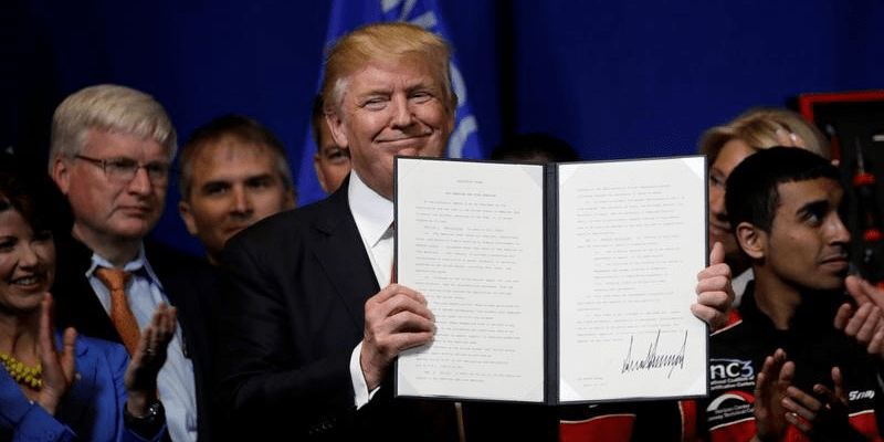 FILE PHOTO: U.S. President Donald Trump smiles after signing an executive order directing federal agencies to recommend changes to a temporary visa program used to bring foreign workers to the United States to fill high-skilled jobs during a visit to the world headquarters of Snap-On Inc, a tool manufacturer in Kenosha, Wisconsin, U.S., April 18, 2017.  REUTERS/Kevin Lamarque