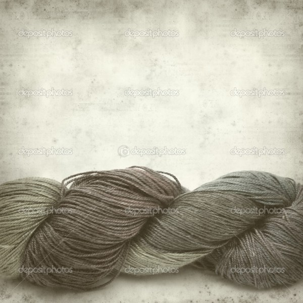 Textured old paper background with handdyed yarn skein