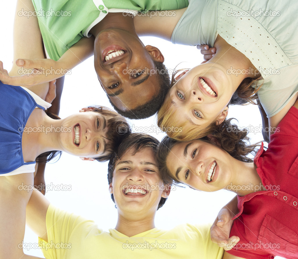 Group Of Teenagers Looking Down Into Camera