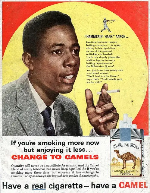 "In 1929, Lucky Strike claimed ""many prominent athletes smoke Luckies all day long with no harmful effects to wind or physical condition."" In the 1950s, Camel used Hank Aaron (pictured) to sell cigarettes."