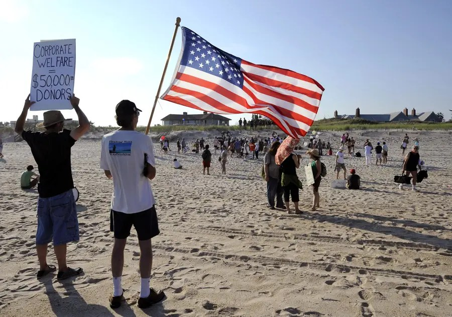 Activists also protested outside Koch's beachfront home.