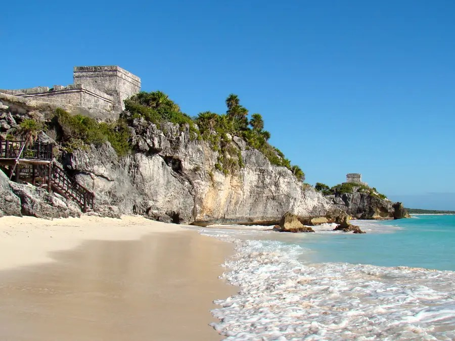 Tulum, Mexico, is known as the site of some ancient Mayan ruins, but it's also home to a phenomenal beach where you can swim in the clear waters while looking out at the ancient structures.