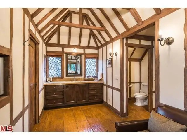 The wood beams are everywhere, even in the bathrooms.