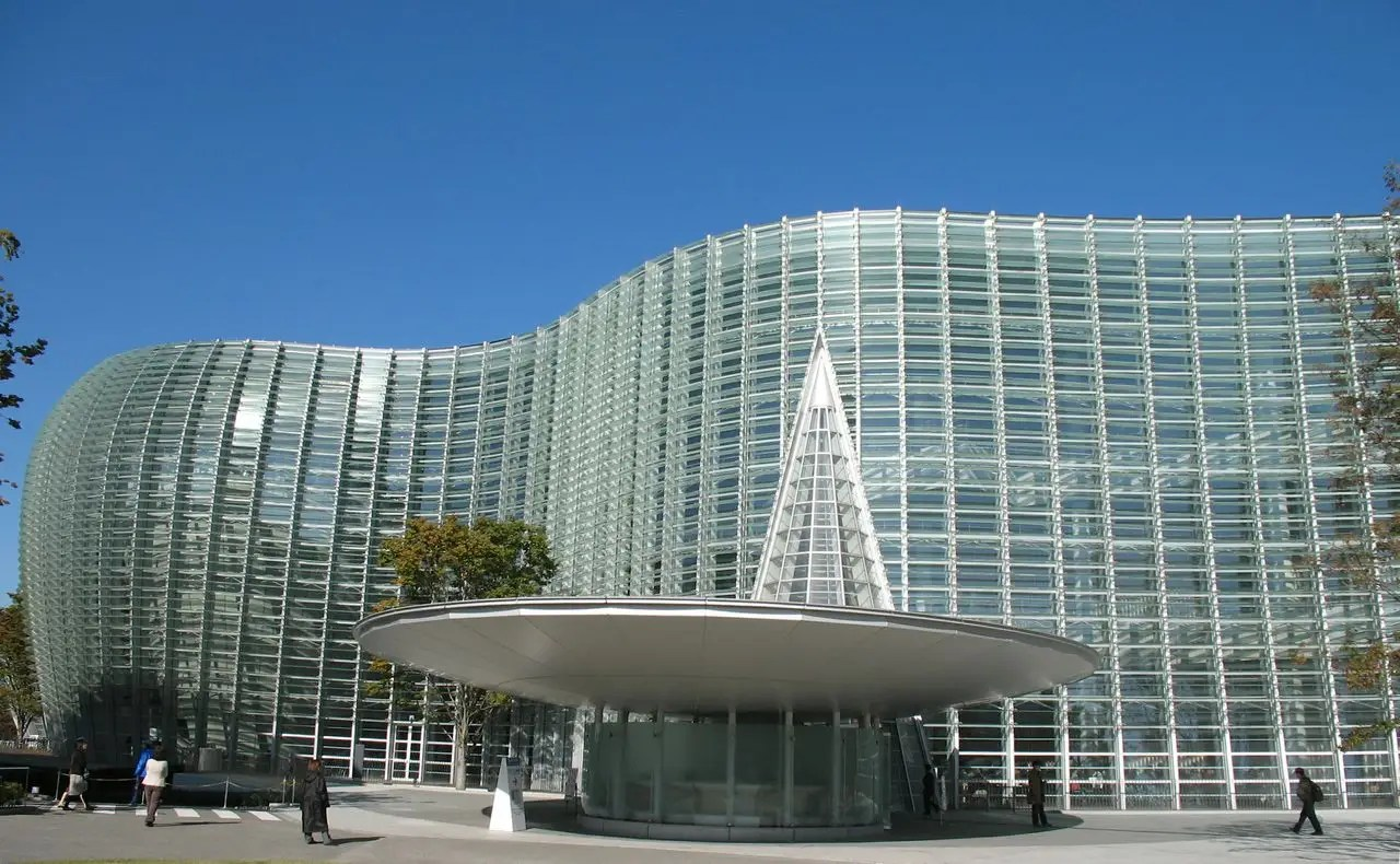 The National Art Center in Tokyo, Japan has fins over its wavy glass facade to prevent direct light from entering.