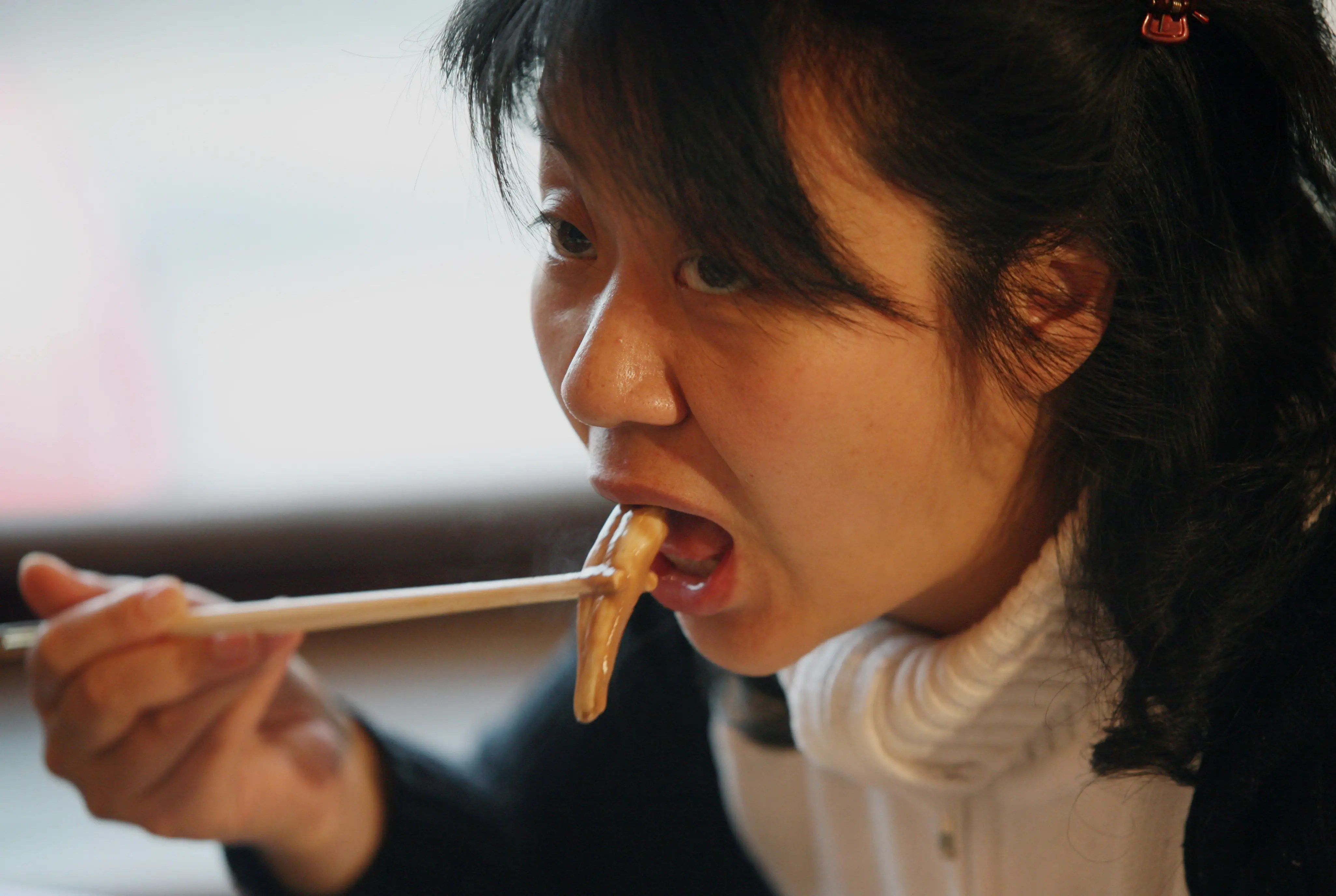 A Chinese woman eats from an ox and dog penis dish at a penis restaurant in Beijing that serves over 30 types of animal penises in traditional hotpot style. In China, many animal penises are thought to have medicinal properties.