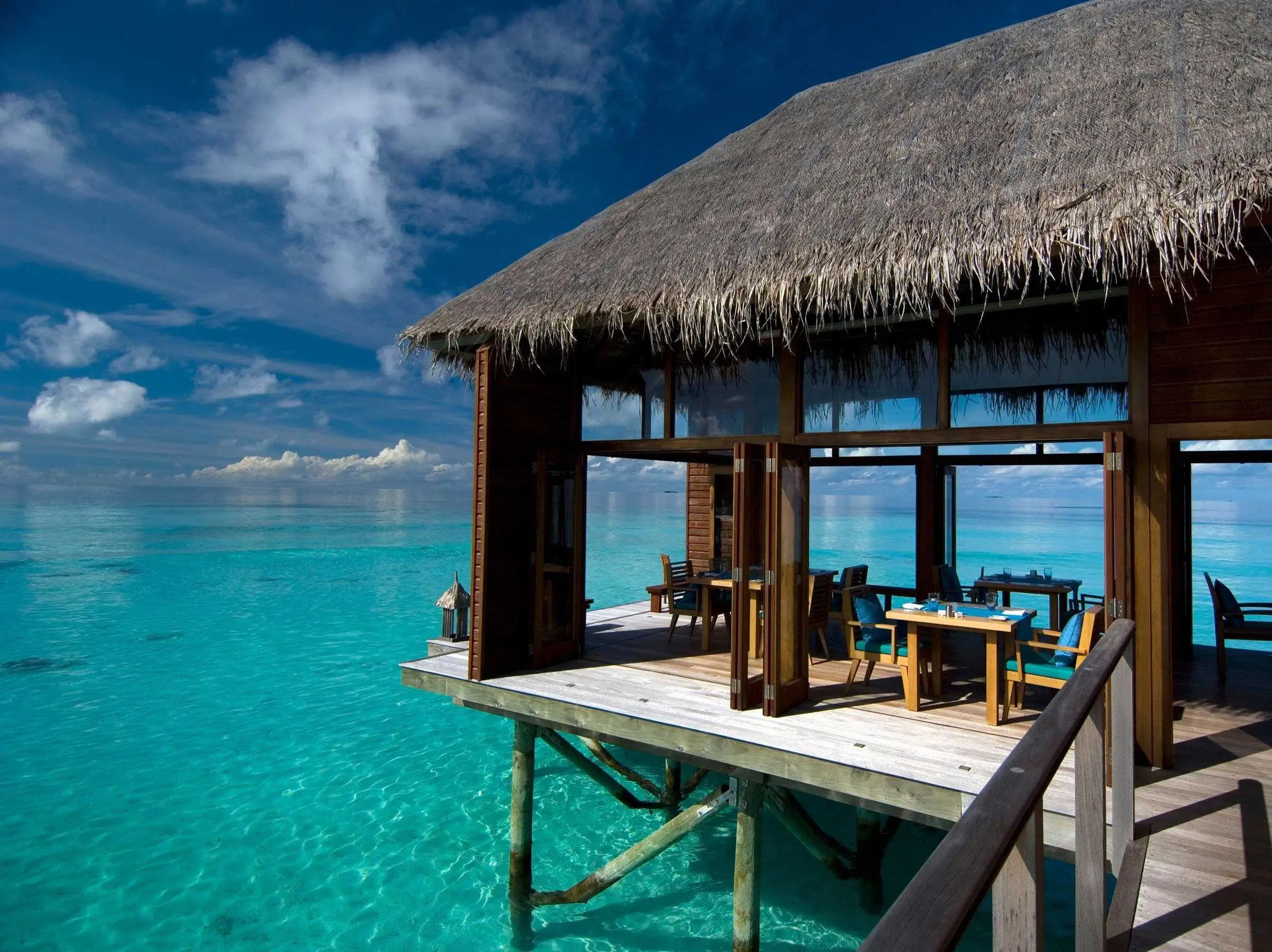 Stay in a luxury hut over the clear aqua waters of the Maldive Islands.
