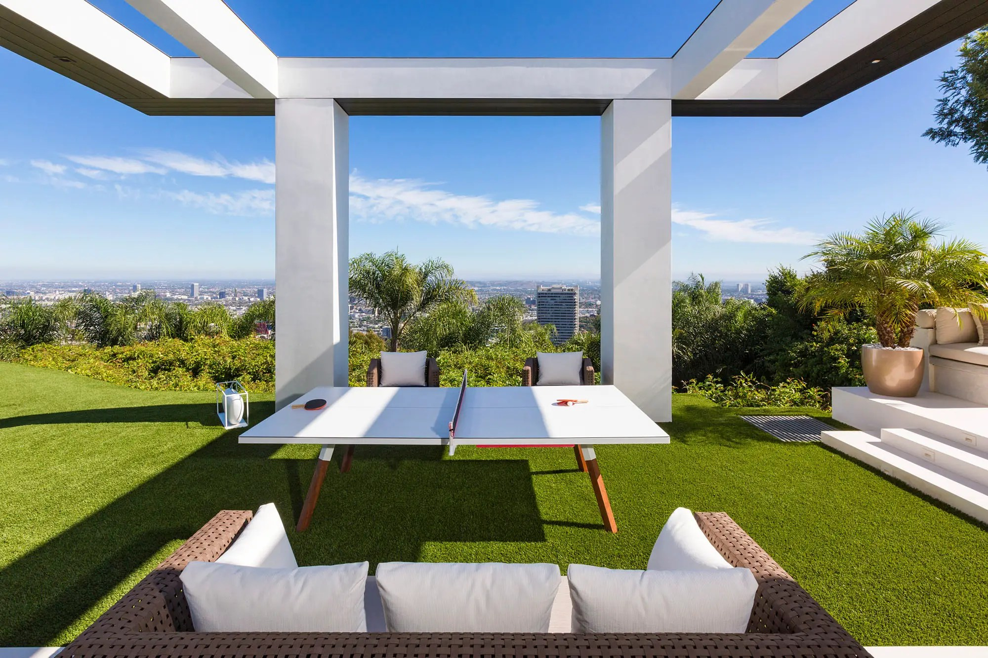 With couches and a ping-pong table, this would be a wonderful area to relax.