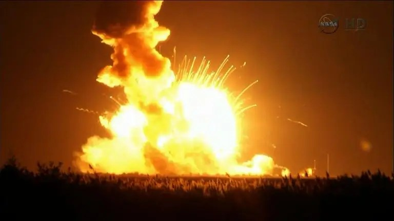 A NASA video image shows an Orbital Sciences Corporation unmanned spacecraft exploding on October 28, 2014 at Wallops Island, Virginia, six seconds after launch