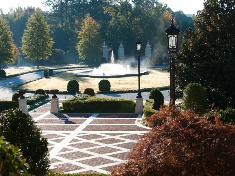 The mansion sits on 14.5 acres, most of it immaculately landscaped with patios, lamp posts, and water features.