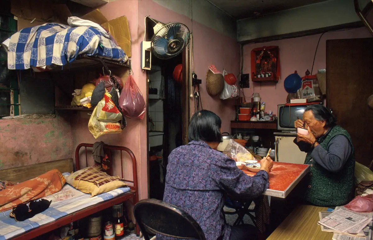According to Girard, the Walled City had a village culture because of the tight living and working quarters. 90-year-old Law Yu Yi lived with her son's wife in a cramped third-floor apartment. It is typical for women to look after her in-laws.