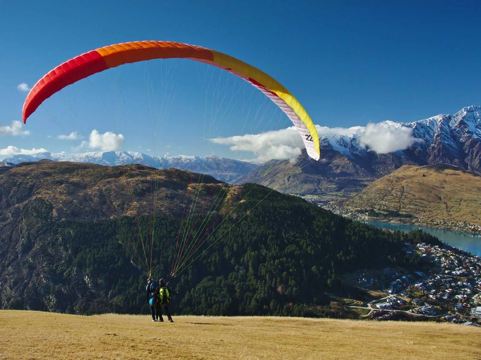Paraglide over the mountains and water surrounding the picturesque city of Queenstown, New Zealand.