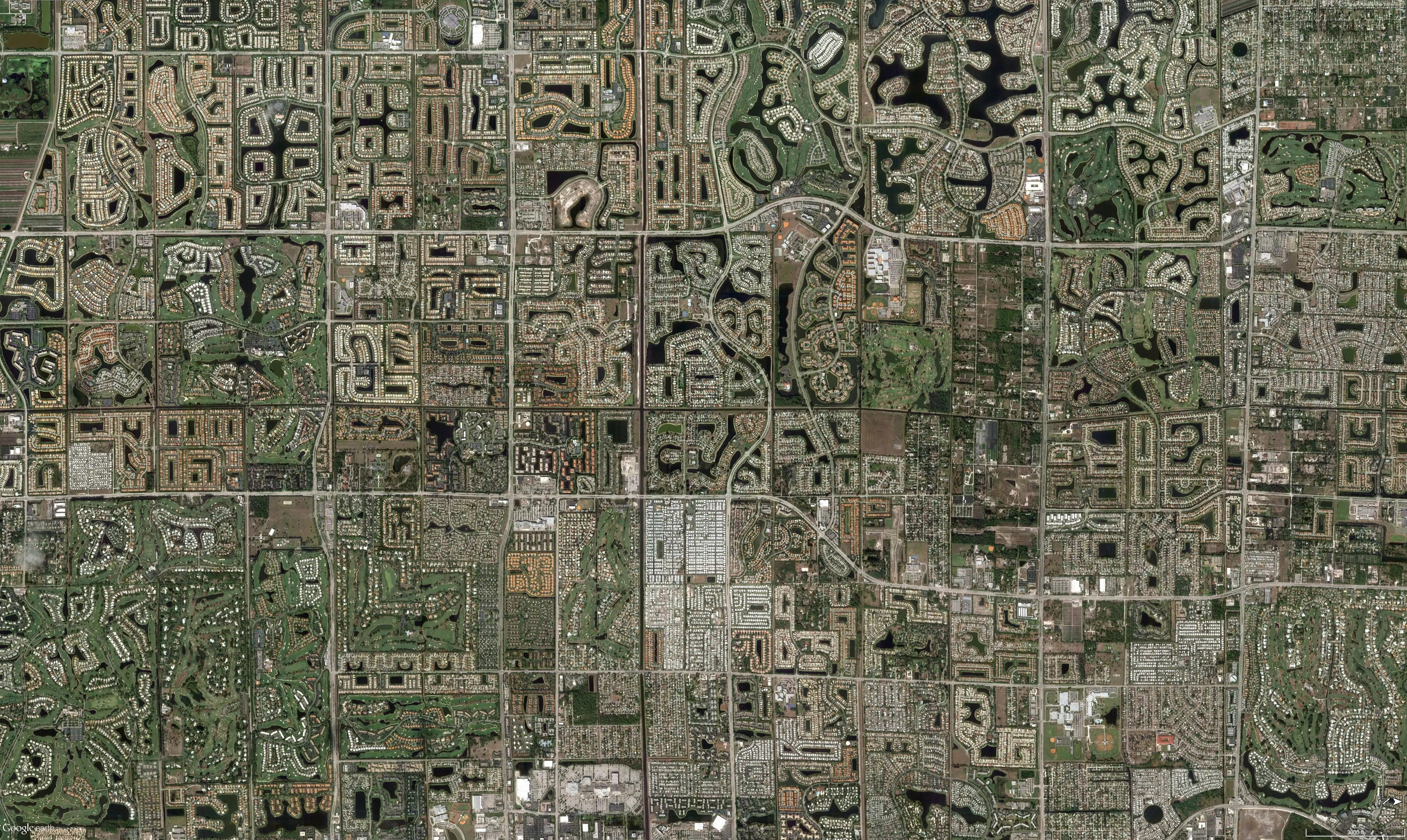 This view from above of the landscape outside Miami, Florida, shows 13 golf courses amongst tract homes on the edge of the Everglades. The area has suffered from depleting water resources, as well as a surge in people moving to the area and developing the land.
