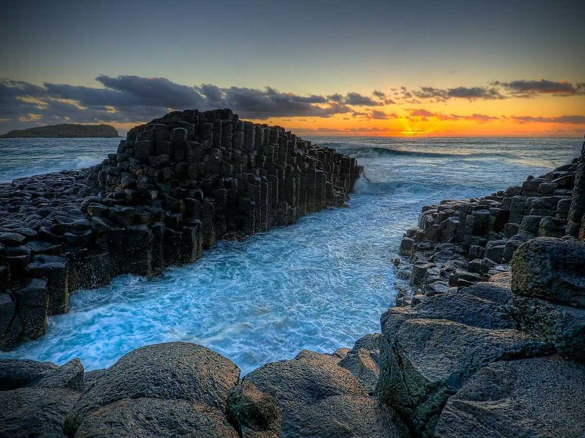 About 40,000 massive basalt columns have formed the stunning Giant's Causeway, located on the Antrim plateau in Northern Ireland. The dramatic landscape has inspired everything from legends in Scotland to art and album covers of famous bands like Led Zeppelin.