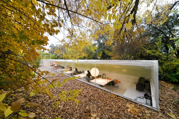 The studios of Selgas Cano Architecture, in Madrid, are tucked inside the woods and nestled partially underground.