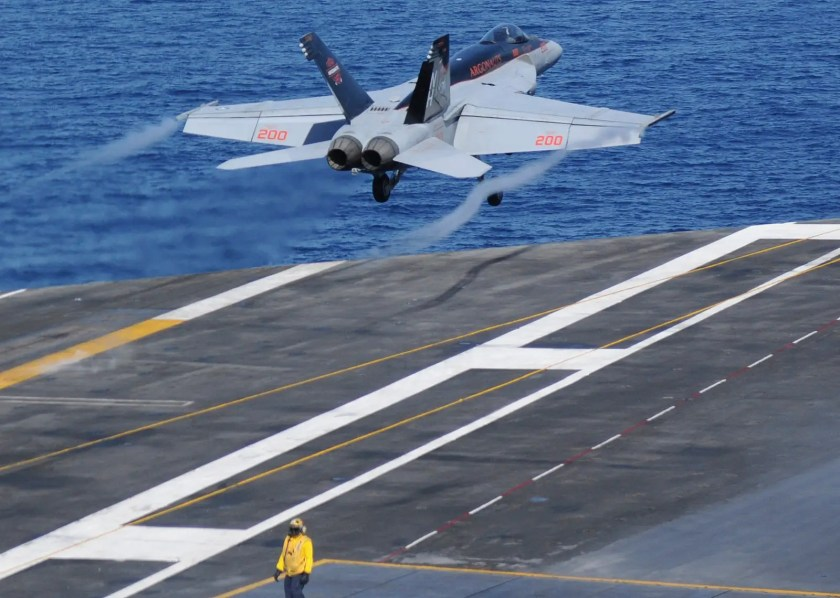 """An F/A-18E Super Hornet, assigned to the """"Argonauts"""" of Strike Fighter Squadron 147, launches off the the flight deck of the aircraft carrier USS Nimitz."""