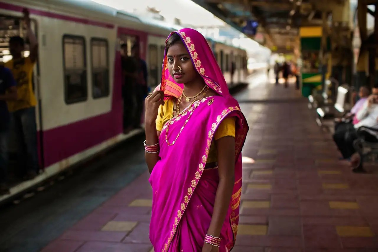 """[In India] I photographed subjects from very different environments,"" Noroc tells Tech Insider. ""From poor women living in slums to Sonam Kapoor, one of the most popular Indian actresses."" Here, an Indian woman poses at a train station."