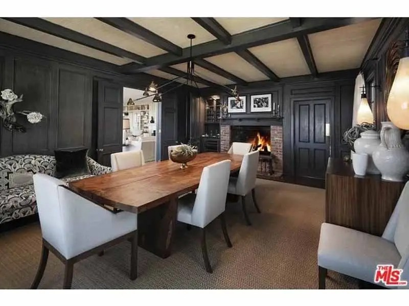 But the formal dining room is finished with dark gray woods.