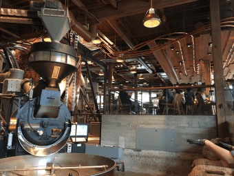 Pneumatic transfer tubes move the beans from the roaster to the containers, coffee silos, or bags of Starbucks Reserve coffee beans that will be sold across the world.