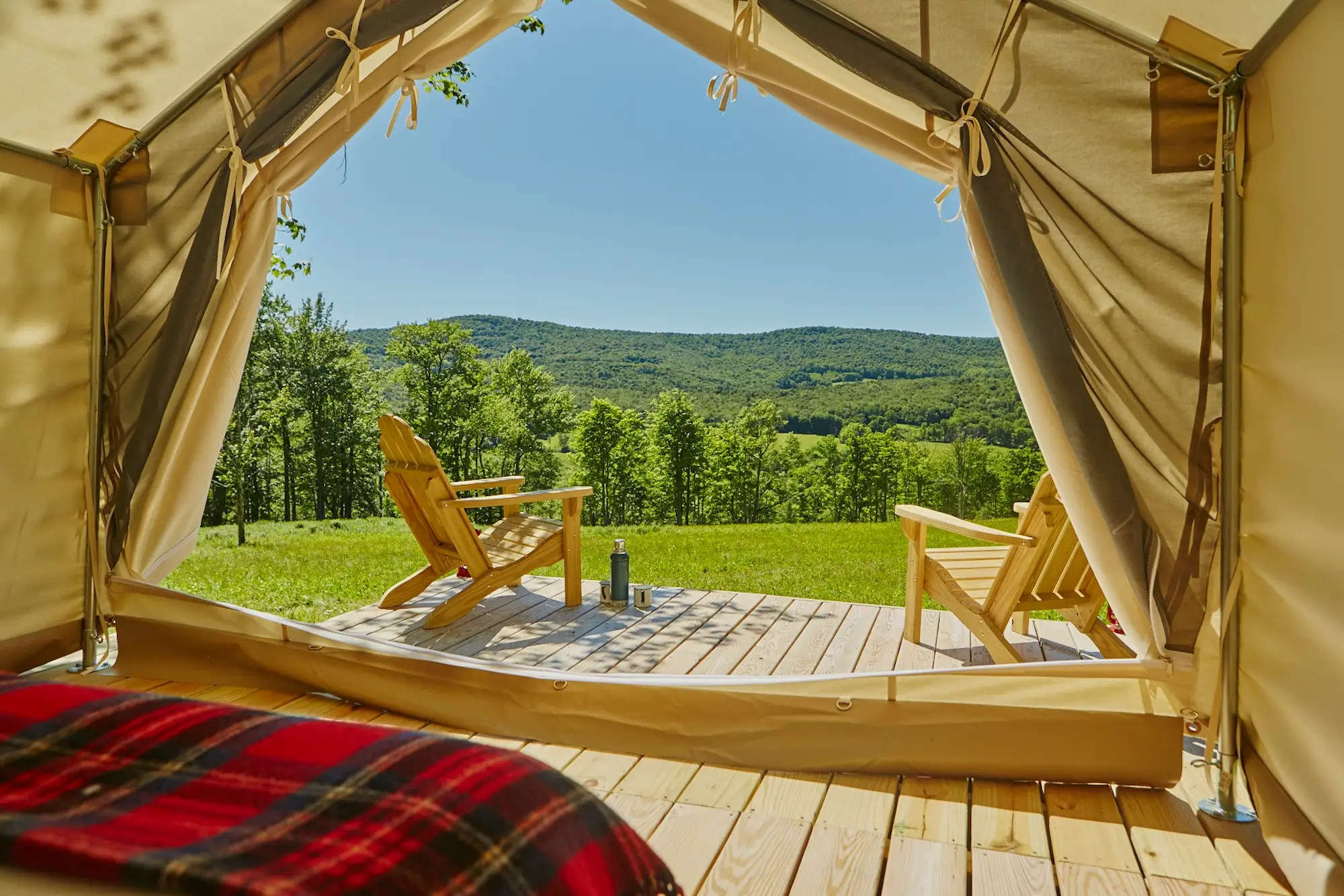 Guests can tie up the door flaps to take in the views of their private campsite.