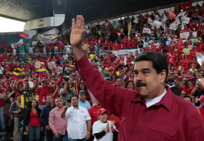 Venezuela's President Nicolas Maduro waves during a pro-government rally with workers of state-run oil company PDVSA, in Barcelona, Venezuela July 8, 2017. Miraflores Palace/Handout via REUTERS  Trump: 'I'm not going to rule out a military option' for Venezuela Trump: 'I'm not going to rule out a military option' for Venezuela phone calls dismissal threats venezuela pressures state workers to vote