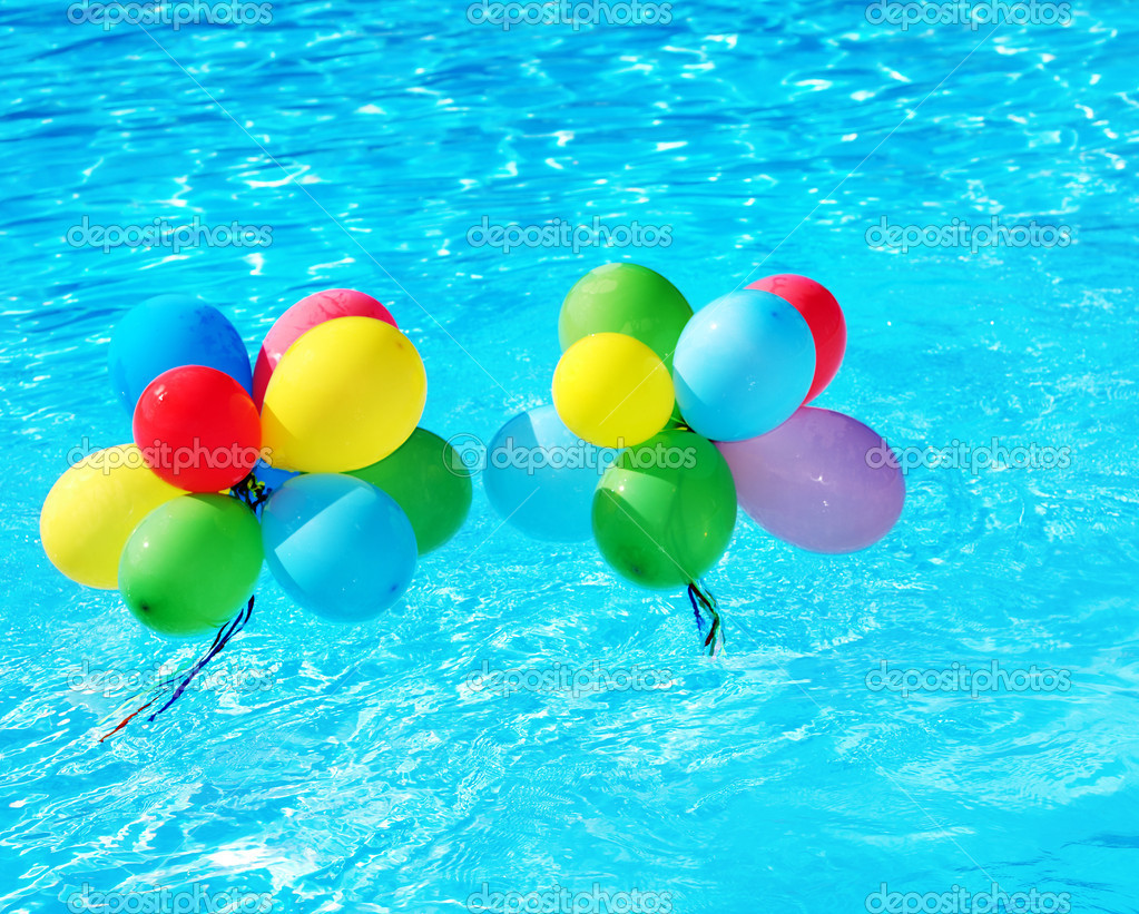 balloons floating in swimming