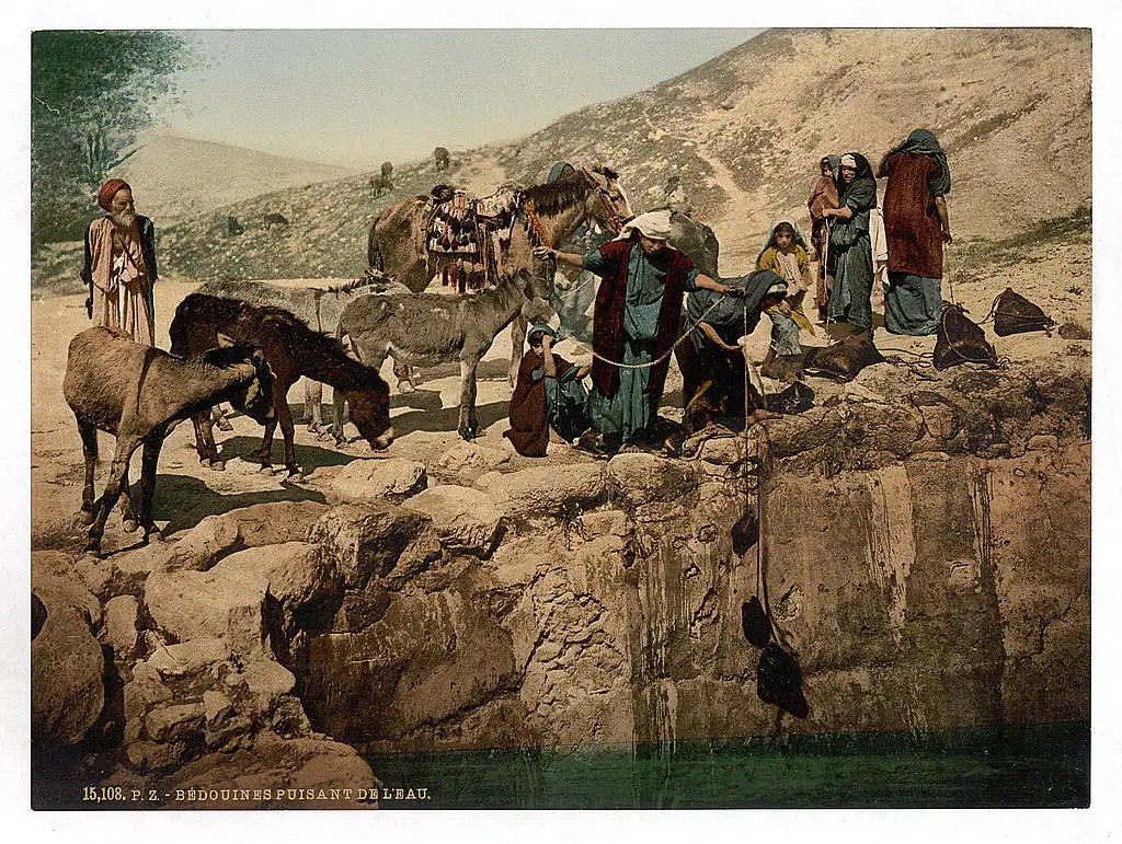 Bedouins drawing water