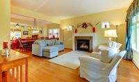Living room with fireplace in soft yellow and blue ...