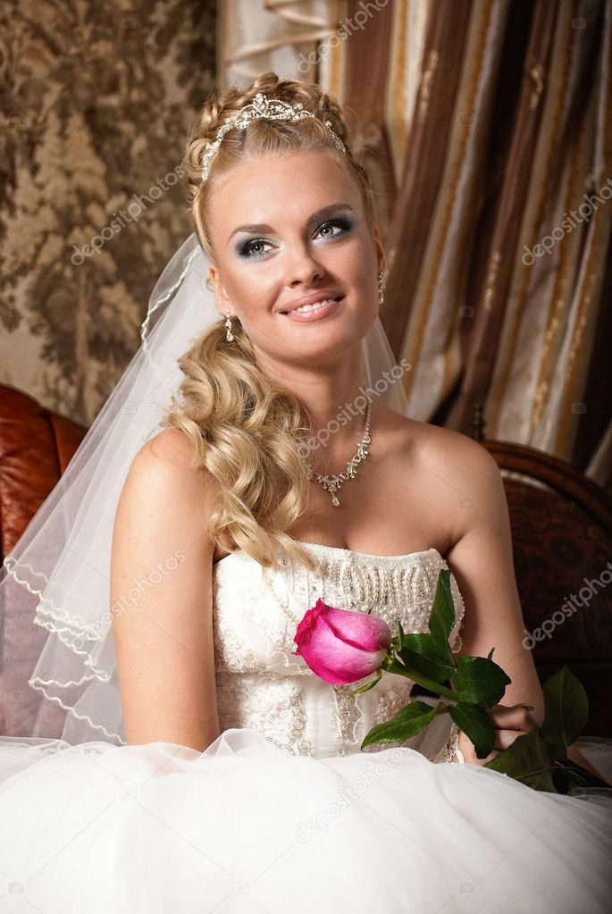 Beautiful young bride with flower  Stock Photo  JANIFEST