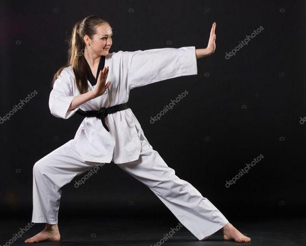 Girl In Kimono Exercising Karate Kata Stock