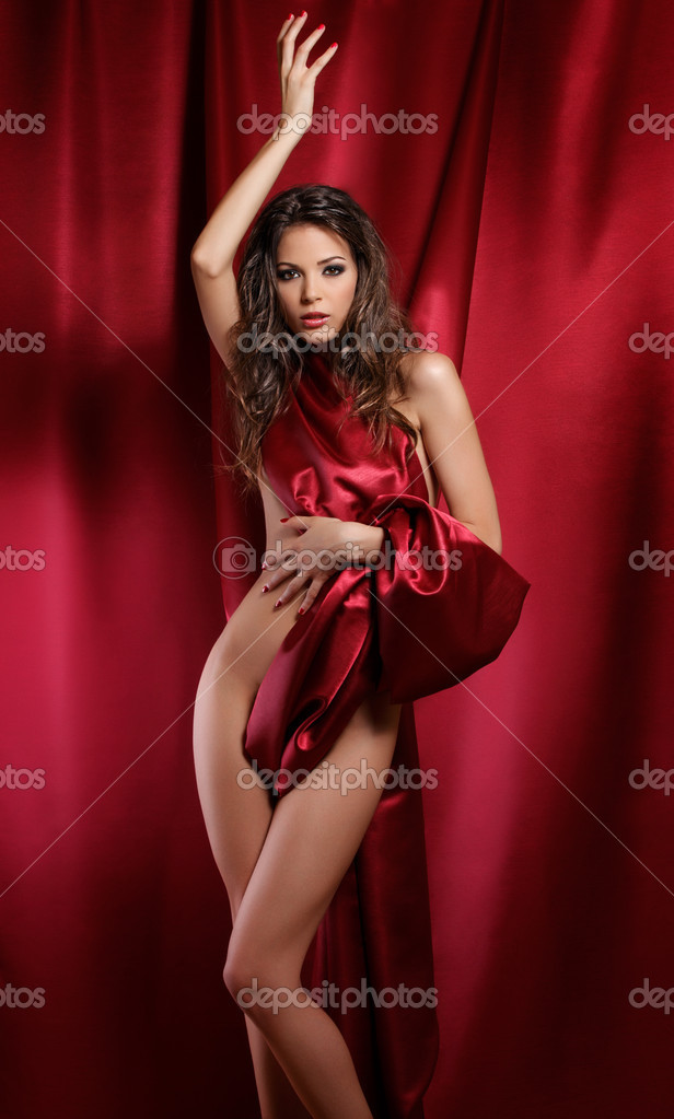 Sexy Lady In Red Textile Stock Photo