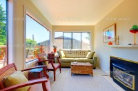 Bright sunny living room with fireplace and sofa.  Stock ...