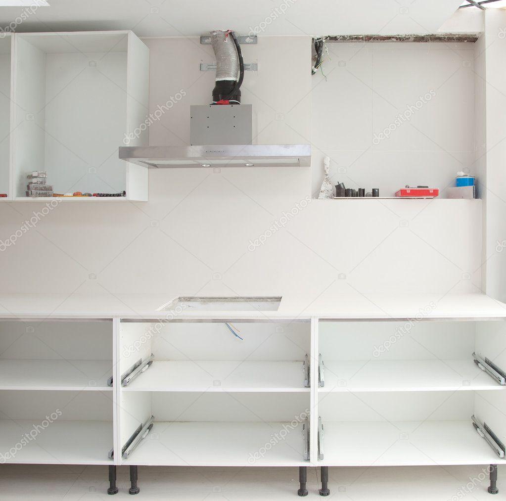 kitchen fan cover and bath design center 厨房的室内装饰设计施工 图库照片 c tono balaguer 10583433 一个电饭锅抽风机风扇罩的厨房室内设计施工 照片作者tono
