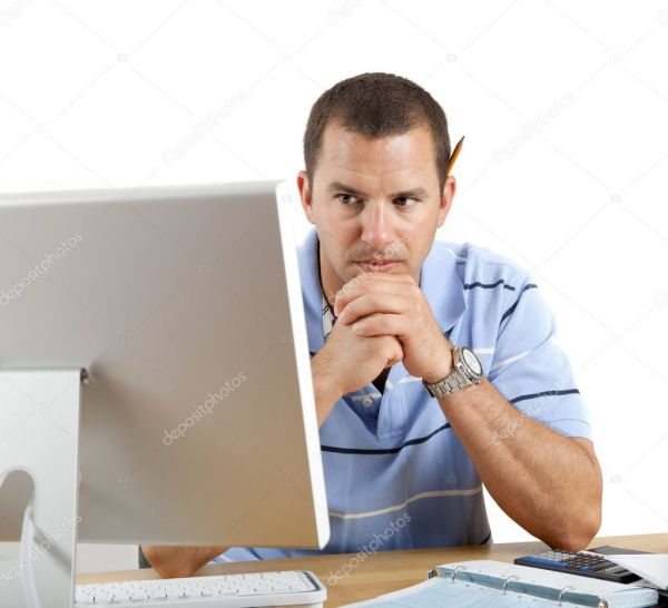 Worried Man at Desk and Computer Paying Bills — Stock ...