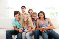 Teenagers playing video games in the living-room  Stock ...