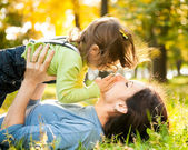 Woman with child in autumn — Stockfoto #10909964