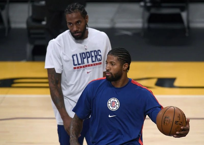 Paul George and Kawhi Leonard of the LA Clippers warm up against the Los Angeles Lakers