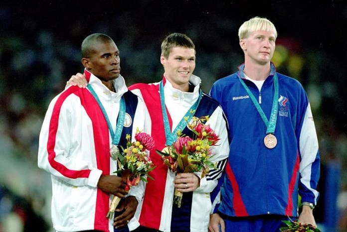 USA's Gold Medal winner Nick Hyesong belongs to Lawrence Johnson of the USA, who wins the Bronze winning silver and Maksim Tarasov in the Men's Pole Vault during the Sydney 2000 Olympic Games.