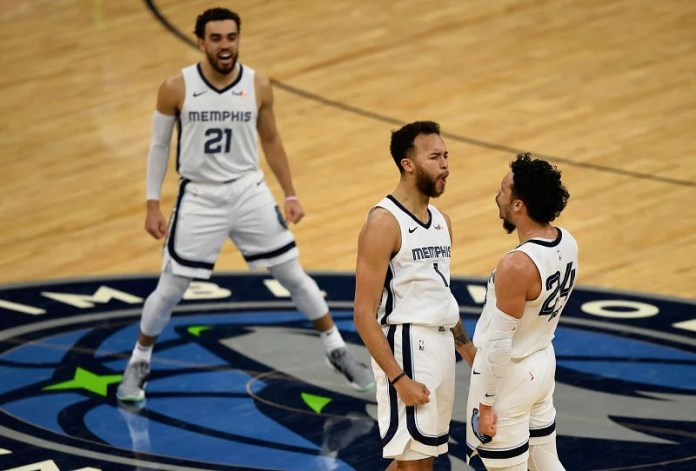 Tys Jones # 21, Kyle Anderson # 1 and Dillon Brooks # 24 of the Memphis Grizzlies