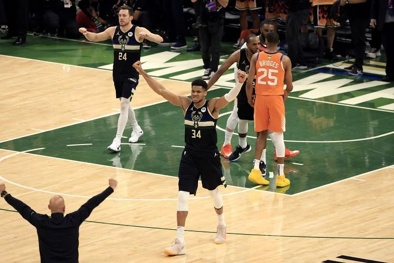 Giannis Antetokounmpo #34 celebrates after defeating the Phoenix Suns.