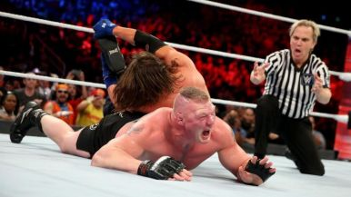 Styles applies the Calf Crusher to Lesnar's injured leg.