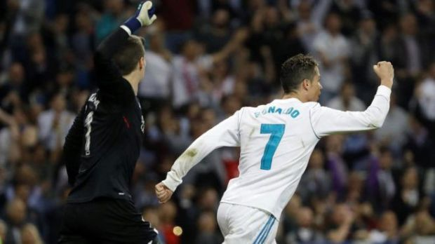 Ronaldo celebrates his 24th league goal while Kepa remonstrates with the officials