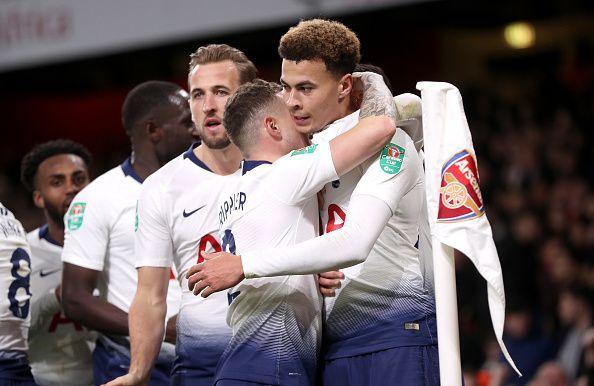 Alli celebrates his deft finish with Spurs teammates during their 2-0 quarter-final win