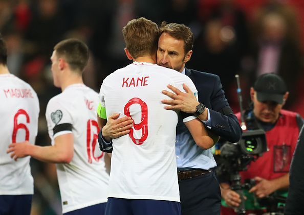 Kane is embraced by manager Southgate at the full-time whistle after an impressive all-round display