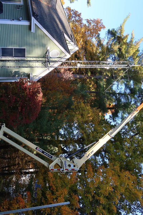 Old Antenna Assembly Takedown Using Boom Lift