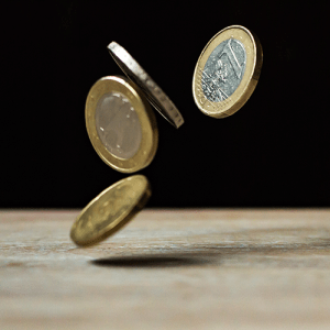 Photo of a coin toss to represent a process that produces independent and identically distributed data.