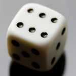 Photo of a die for examples of probabilities of different outcomes.