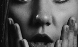 Photograph of a woman with a shocked expression.