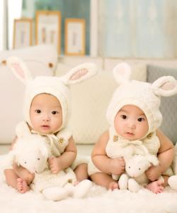 Photograph of matching babies.