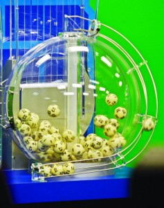 Photograph showing the Powerball lottery drawing machine with the numbered balls.